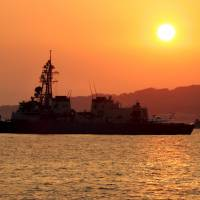 Japanese warships are seen off Genkaijima Island, Fukuoka Prefecture, in this 2005 file image. | REUTERS