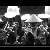 This screen shot shows an NTT Docomo video released Tuesday in which samurai are distracted by their smartphones while on a march.