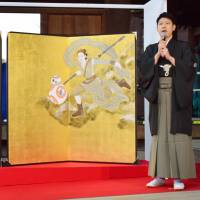 Artist Taro Yamamoto unveils screens featuring characters from the upcoming 'Star Wars' film rendered in the Rimpa school at Kiyomizu Temple in Kyoto on Monday. | KYODO