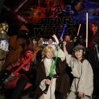 'Star Wars' fans have their photos taken Friday at Toho Cinemas' Roppongi Hills theater in Minato Ward, Tokyo, ahead of the first showing of 'The Force Awakens.' | RIE ISHII