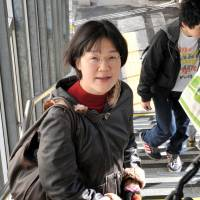 Kaori Oguni is suing the government over the constitutionality of a Civil Code provision that requires married couples to adopt one surname. She is seen on Nov. 17 in Tokyo's Nakano Ward.   YOSHIAKI MIURA
