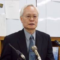 Chuo University professor Yoshiaki Yoshimi addresses reporters at the Osaka City Hall in June 2013. | KYODO
