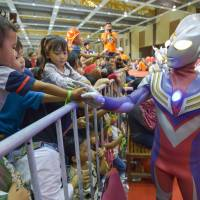 Some of the dozens of Ultraman characters from over the years on the set of a new Ultraman movie at the Nikkatsu Chofu Studio in Tokyo on Oct. 1. Footage that will see tokusatsu special effects is recorded using the camera in the foreground. | KYODO