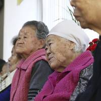 South Korean former 'comfort women' wait Monday in Gwangju for results of a meeting between the Japanese and South Korean foreign ministers. | AP