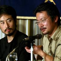 Freelance journalist Jumpei Yasuda (left) and human rights activist Nobutaka Watanabe address the Foreign Correspondents' Club of Japan in Tokyo in April 2004. | REUTERS