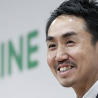 Sounding off: Takeshi Idezawa, chief executive officer of Line Corp., speaks to reporters earlier this month. Line's music-streaming service, Line Music, debuted in July but has had problems getting its users to pay for the service. | BLOOMBERG