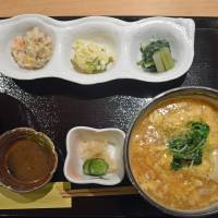 Tres chic: Lunch at Sakuya is served all at once on a lacquered tray, and includes (left to right) kaisendon (seafood rice bowl), vegetable appetizers and ankake udon (wheat noodles in a thickened broth). | J.J. O'DONOGHUE