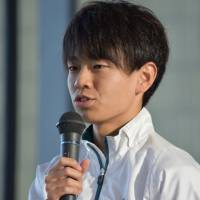 Quietly confident: Aoyama Gakuin University student Daichi Kamino speaks to reporters at a news conference in Tokyo in December. | MIINA YAMADA