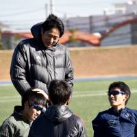 'Happy tactics': Members of the Aoyama Gakuin University ekiden team relax with a teacher during training in December. | MIINA YAMADA