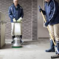 Eiji and Kumiko Ishikawa (not their real names) clean an apartment complex in Tokyo on Dec. 15.  | ROB GILHOOLY