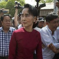 National League for Democracy leader Aung San Suu Kyi visits a polling station on the outskirts of Yangon in November. | AP