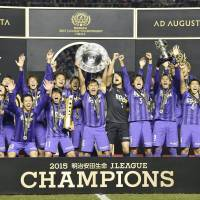 Sanfrecce Hiroshima players celebrate the team's J. League title on Saturday at Edion Stadium, where they wrapped up a 4-3 aggregate victory in the two-leg championship final over Gamba Osaka. | KYODO