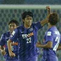 Sanfrecce's Yusuke Minagawa celebrates after scoring his team's first goal during Hiroshima's 2-0 win over Auckland City during the Club World Cup on Thursday in Yokohama. | REUTERS