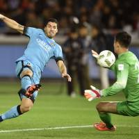 Barcelona's Luis Suarez scores the second of his three goals against Guangzhou Evergrande goalkeeper Li Shuai in the 50th minute during the Club World Cup semifinals on Thursday at Nissan Stadium in Yokohama. Barcelona won 3-0. | KYODO