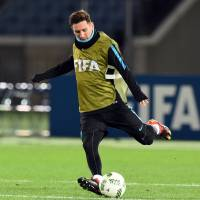 Barcelona's Lionel Messi participates in a training session on Saturday, a day before the Club World Cup final, in Yokohama. | AFP-JIJI