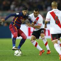Barcelona's Neymar tries to control the ball against River Plate on Sunday. | REUTERS