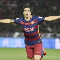Luis Suarez celebrates after scoring during Barcelona's victory in the Club World Cup final. | KYODO