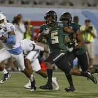 Bears running back Johnny Jefferson runs 80 yards for a touchdown as Tar Heels cornerback M.J. Stewart gives chase during the Russell Athletic Bowl on Tuesday in Orlando, Florida. | USA TODAY / REUTERS