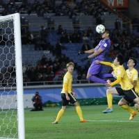 Douglas heads in the decisive goal for Sanfrecce during the third-place game of the Club World Cup on Sunday in Yokohama.   AP