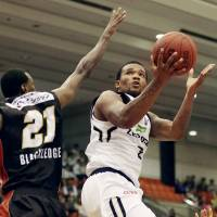 Ryukyu star Draelon Burns, seen in a file photo, had 17 points and 10 rebounds against visiting Akita on Saturday. The Golden Kings beat the Northern Happinets 99-63 in the series opener. | KYODO