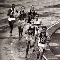 France's Michel Jazy (124) leads the men's 5,000-meter final as Bob Schul of the United States (719) and West Germany's Harald Norpoth (trailing Schul) follow with 100 meters remaining at the 1964 Tokyo Olympics. Schul claimed the gold. | MARK SHEARMAN