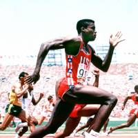 American Carl Lewis, who won 10 Olympic medals (nine gold) over the years, is captured on film during the 1984 Los Angeles Summer Games. | MARK SHEARMAN