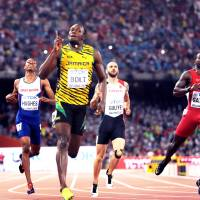 Jamaica's Usain Bolt exhibited his showmanship after his 200-meter triumph at the 2015 IAAF World Championships in Beijing. | MARK SHEARMAN