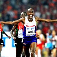 Great Britain's Mo Farah celebrates his triumph in the men's 10,000 meters at the 2015 IAAF World Championships in Beijing. | MARK SHEARMAN