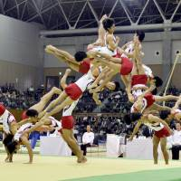 Kenzo Shirai competes in the Toyota International Gymnastics Competition on Saturday. Shirai is seen performing his double-backward somersault triple-twisting layout. | KYODO