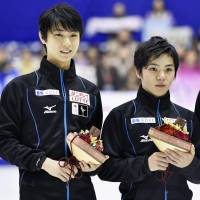 Yuzuru Hanyu (left) and Shoma Uno are members of the team that will represent Japan at the world championships in March. | KYODO