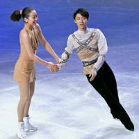 Yuzuru Hanyu and Mao Asada, seen here in the Exhibition Gala at the 2014 world championships, are the favorites heading into this week's Grand Prix Final in Barcelona, Spain. | KYODO