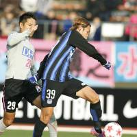 Gamba Osaka's Takashi Usami ends a 15-match scoring drought on Saturday, bagging two in a 3-1 victory over Sagan Tosu in the Emperor's Cup quarterfinals in Osaka. | KYODO