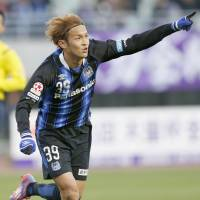 Gamba Osaka's Takashi Usami scored two goals in a 3-0 win over Sanfrecce Hiroshima in the Emperor's Cup semifinals on Tuesday. | KYODO