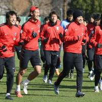 Urawa Reds players train on Thursday, a day before their Emperor's Cup final against Gamba Osaka. | KYODO