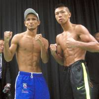 Takashi Uchiyama (right) will be defending his title for the 11th time when he faces Oliver Flores on Thursday. | KAZ NAGATSUKA