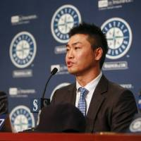 Mariners outfielder Norichika Aoki speaks during an introductory news conference in Seattle on Thursday. | AP