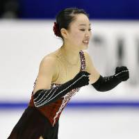 Wakaba Higuchi pumps her fists after her long program on Sunday. Higuchi finished second.   KYODO