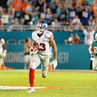 Beckham lifts Giants to win