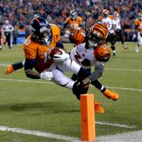 Broncos down Bengals in OT