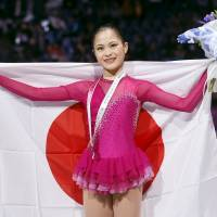 Women's runnerup Satoko Miyahara poses during the medal ceremony at the Grand Prix Final in Barcelona, Spain, on Saturday. | REUTERS