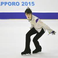 Yuzuru Hanyu performs his free skate routine on Saturday at the All-Japan Championships in Sapporo. Hanyu captured his fourth consecutive national title. | KYODO