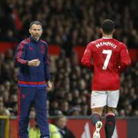 Manchester United assistant manager Ryan Giggs may be called on to take over the club if manager Louis van Gaal is dismissed after a string of poor results. | REUTERS