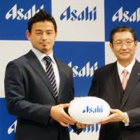 Rugby star Ayumu Goromaru (left) will appear in advertisements for a new Asahi Breweries Ltd. beer called The Dream. | KYODO
