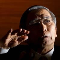 Bank of Japan Gov. Haruhiko Kuroda addresses a news conference at the bank's headquarters in Tokyo on Friday. | REUTERS