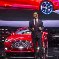 Nissan Motor Corp. Chairman and CEO Carlos Ghosn discusses the new Infiniti Q60 sports coupe at the North American International Auto Show on Monday in Detroit. | AP