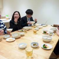 Cookpad employees sample meals based on the company's recipe in Tokyo. The operator of Japan's largest online receipe website has been reportedly rocked by internal management strife. | KYODO