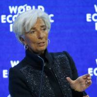 Christine Lagarde, Managing Director of the International Monetary Fund, attends 'The Global Economic Outlook' session during the annual World Economic Forum in Davos, Switzerland, on Saturday. | REUTERS