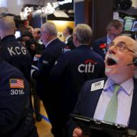 Traders work on the floor of the New York Stock Exchange (NYSE) shortly before the closing bell Monday. U.S. stocks tumbled on Monday, putting the Dow on track for its worst start to a year since 1932 after weak Chinese economic data fanned fears of a global slowdown. | REUTERS