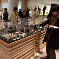 Reporters view Japan Duty Free Ginza on Tuesday. The space is a new duty free shop located within the Mitsukoshi department store in Tokyo's upscale Ginza district. | SATOKO KAWASAKI