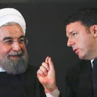 Iranian President Hassan Rouhani talks with Italian Prime Minister Matteo Renzi at the Campidoglio Palace in Rome on Monday. | REUTERS